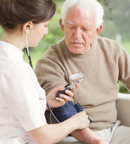 nurse monitoring the blood pressure of the patient