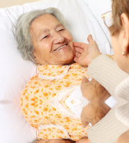 senior patient lying in bed