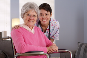 smiling caregiver and old woman