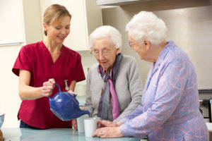 senior women at home with their caregiver